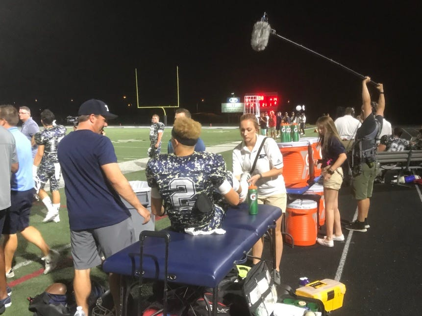 Pinnacle quarterback Spencer Rattler is attended to by the team's training staff after suffering an injury during the first half of a game against Mountain Pointe.