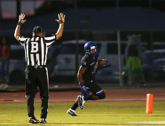 Chandler Decarlos Brooks (25) scores a touchdown during a high school football game against Queen Creek at Chandler High on August 24, 2018. #azhsfb