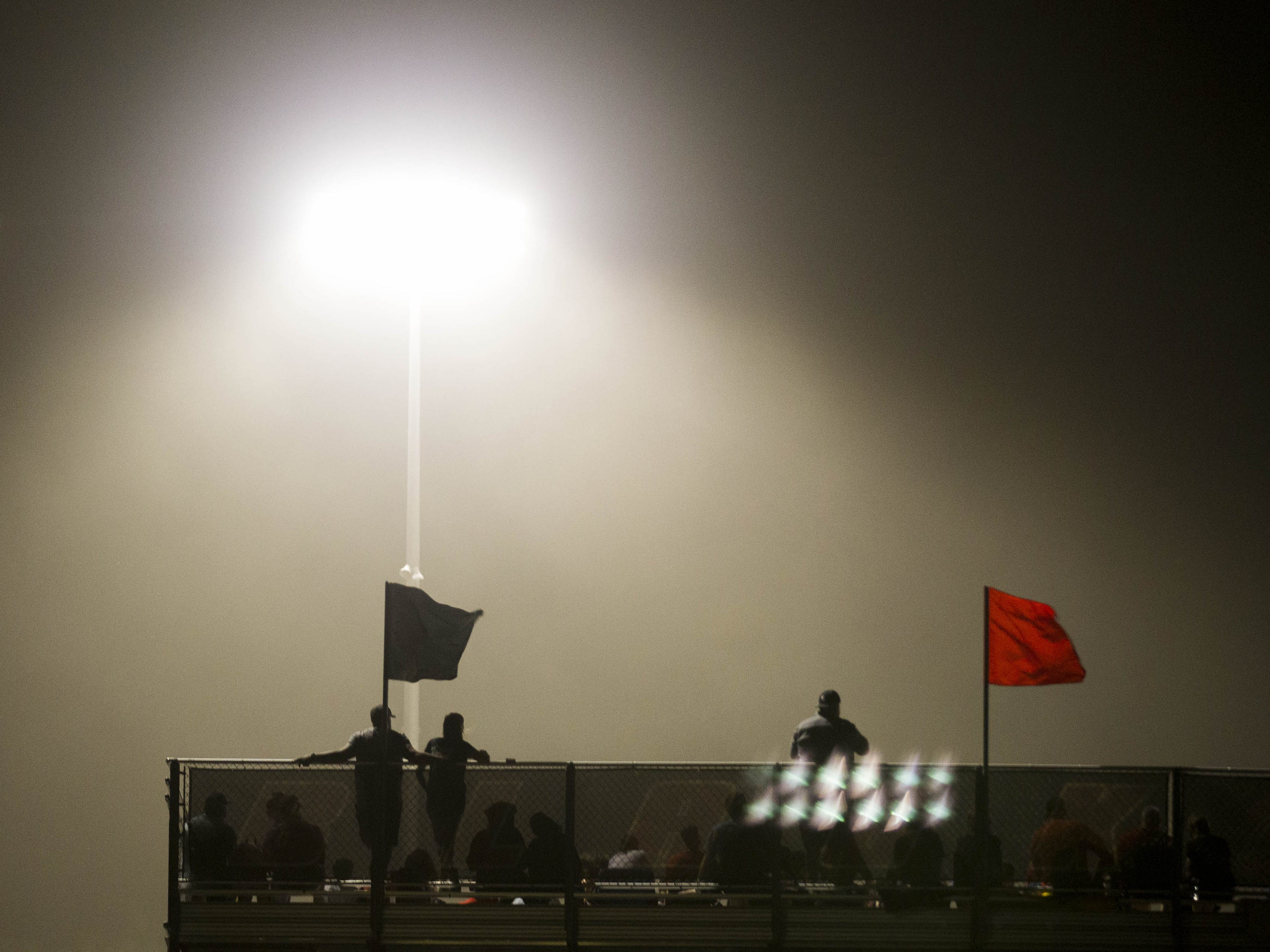 A dust storm blows through the Williams Field-Sunrise Mountain game in Gilbert Friday, Aug.24, 2018.#azhsfb