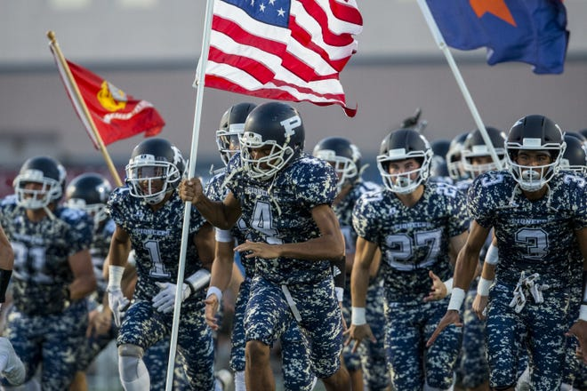 Pinnacle takes the field before their game against Mountain Pointe on Friday, Aug. 24, 2018, at Pinnacle High School in Phoenix.   #azhsfb