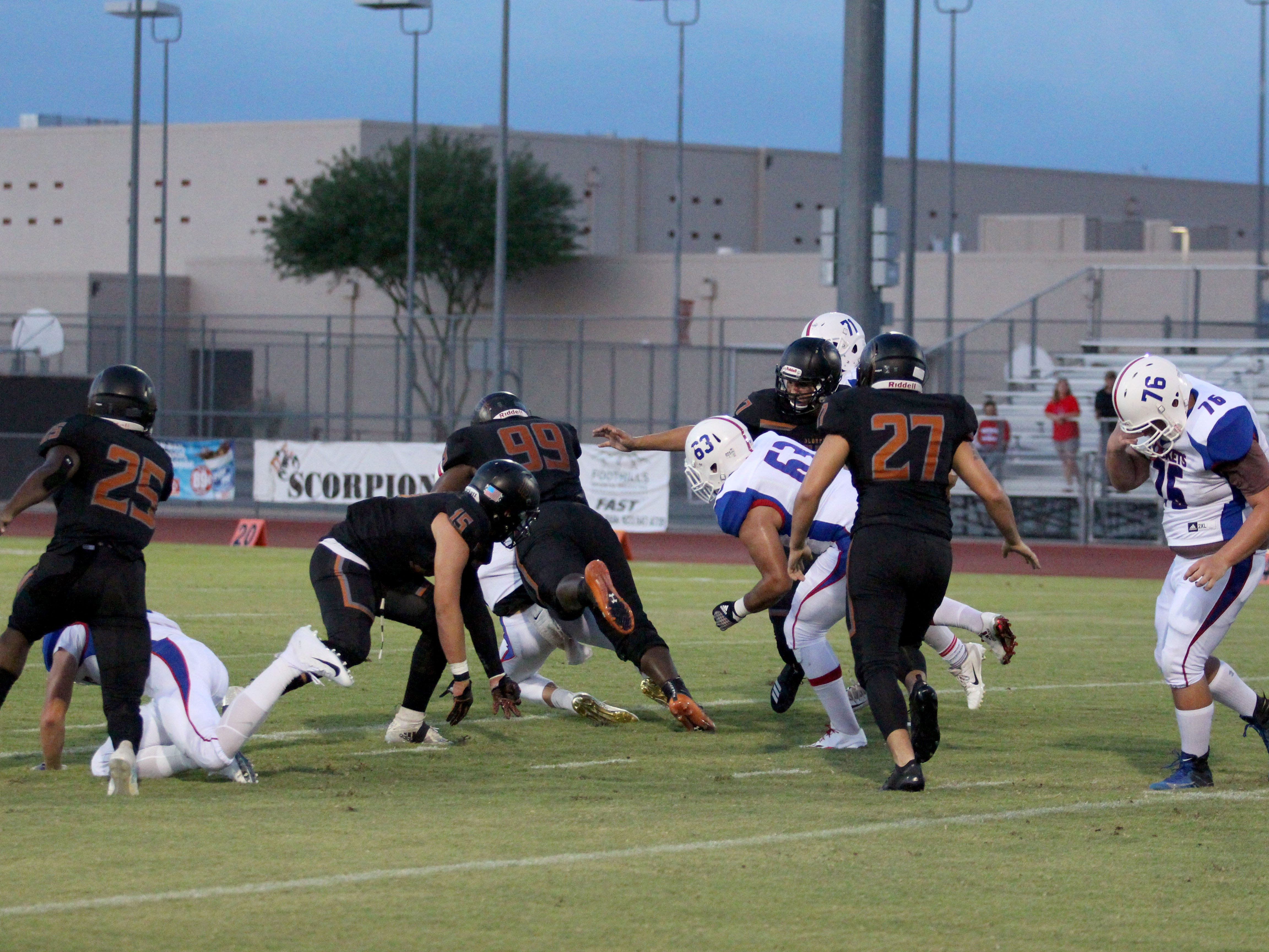 Desert Edge's Nassir Sims gets his second sack against Moon Valley, Goodyear, Ariz. August 24, 2018.
