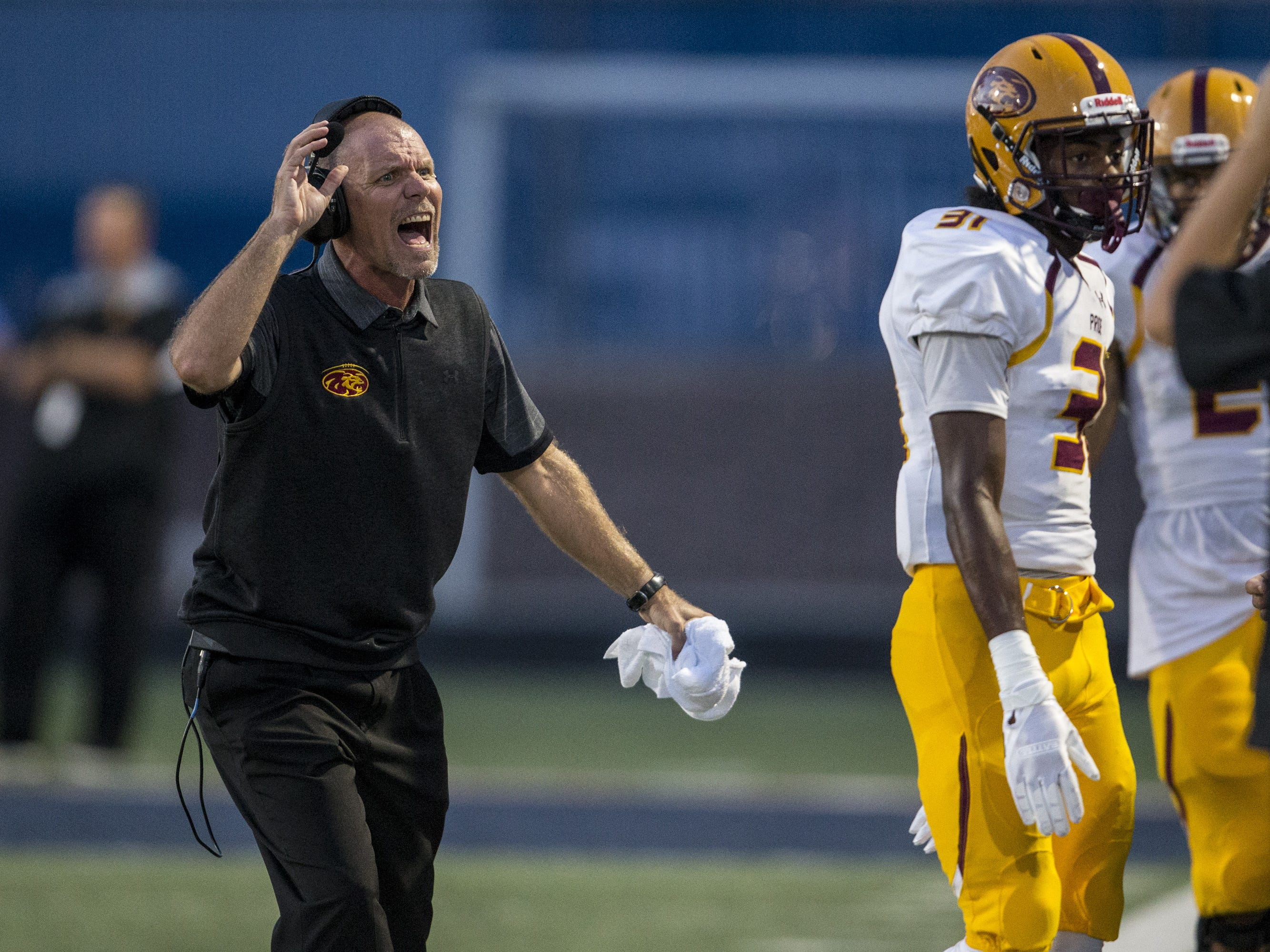 Mountain Pointe head coach Rich Wellbrock shouts during the 1st quarter against Pinnacle on Friday, Aug. 24, 2018, at Pinnacle High School in Phoenix.   #azhsfb