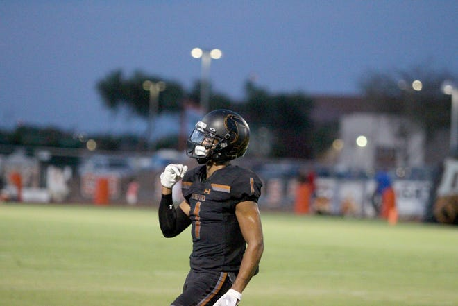 Desert Edge's Steven Ortiz Jr. (1) celebrates after his interception against Moon Valley, Goodyear, Ariz. August 24, 2018.