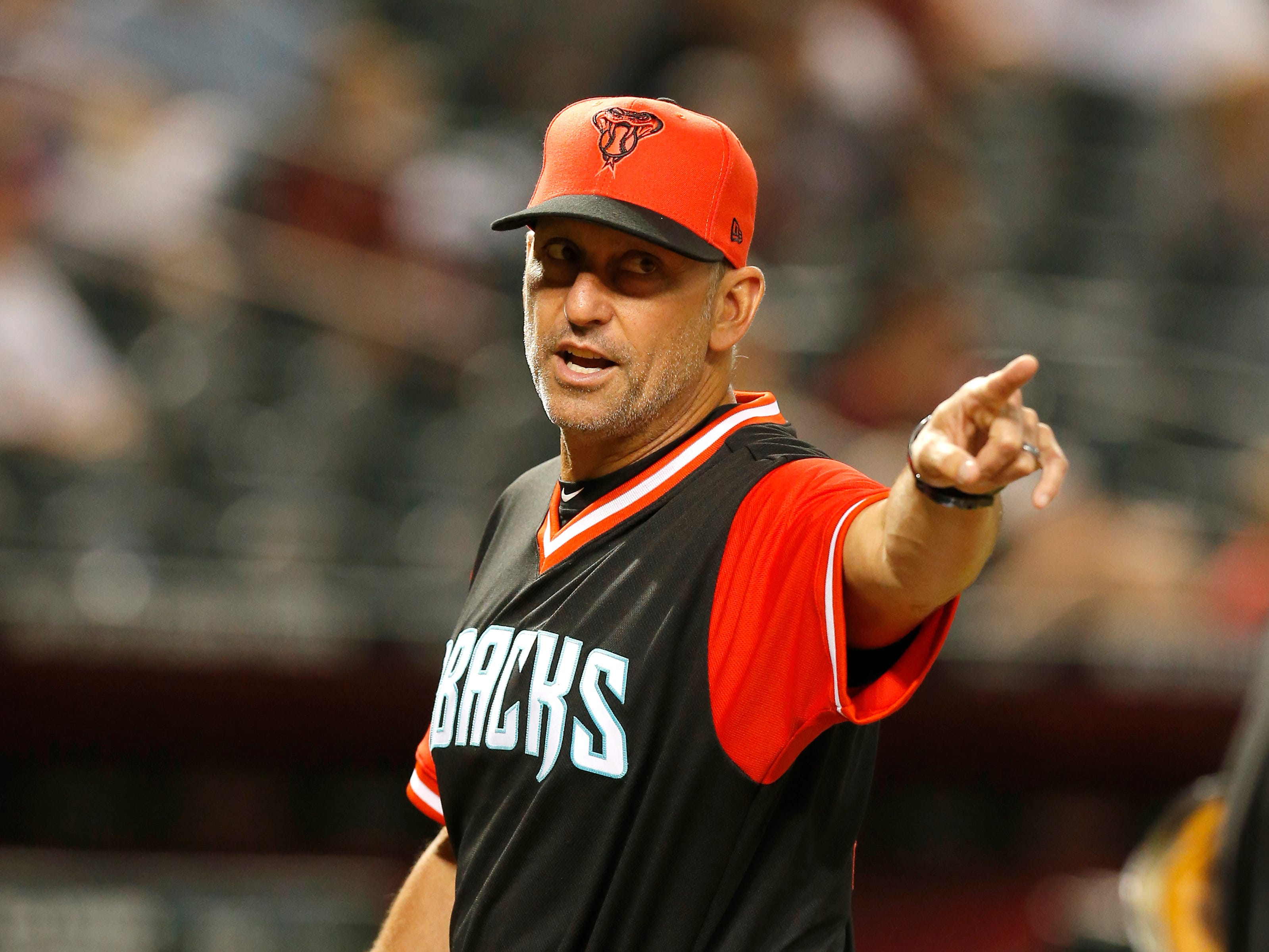 Arizona Diamondbacks manager Torey Lovullo (17) in the first inning during a baseball game against the Seattle Mariners, Friday, Aug. 24, 2018, in Phoenix.