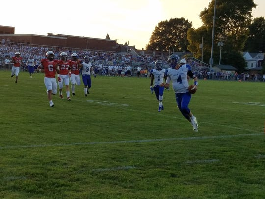 Cedar Crest QB Logan Horn heads to the end zone for the Falcons' first score in Friday's 42-19 Cedar Bowl win over Lebanon.