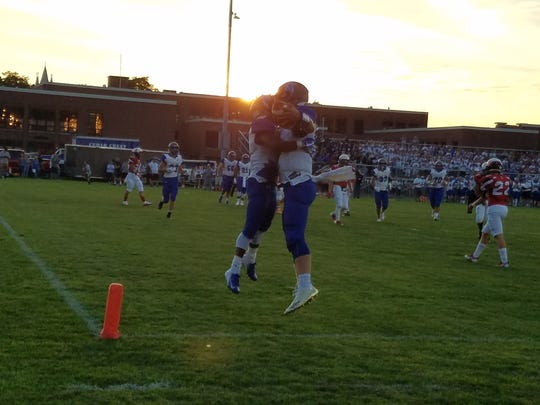 Two Cedar Crest players celebrate a touchdown in Friday's 42-19 Cedar Bowl win over Lebanon.