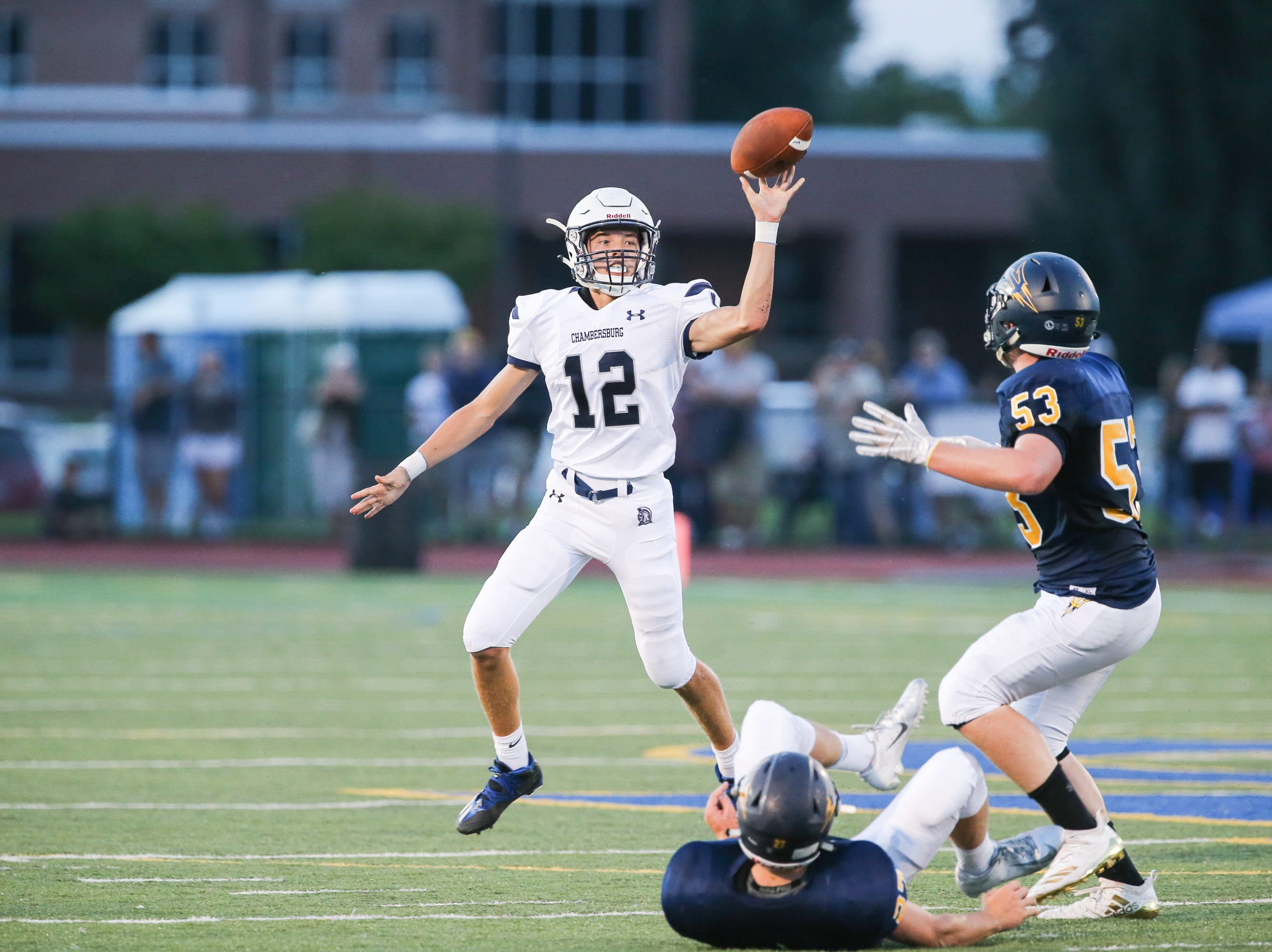 Chambersburg quarterback Brgady Stumbaugh (12) throws the football during the season opener versus Greencastle-Antrim on Friday, Aug. 24, 2018, in Greencastle. Chambersburg won, 48-13.