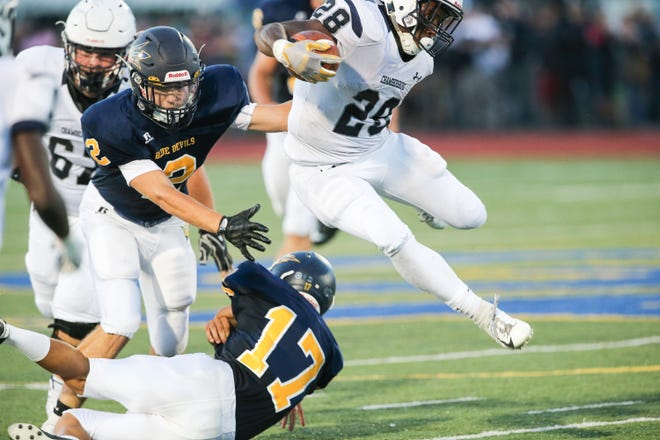 A Chambersburg player jumps over his Greencastle-Antrim opponent during the teams' season opener on Friday, Aug. 24, 2018, in Greencastle. Chambersburg won, 48-13.