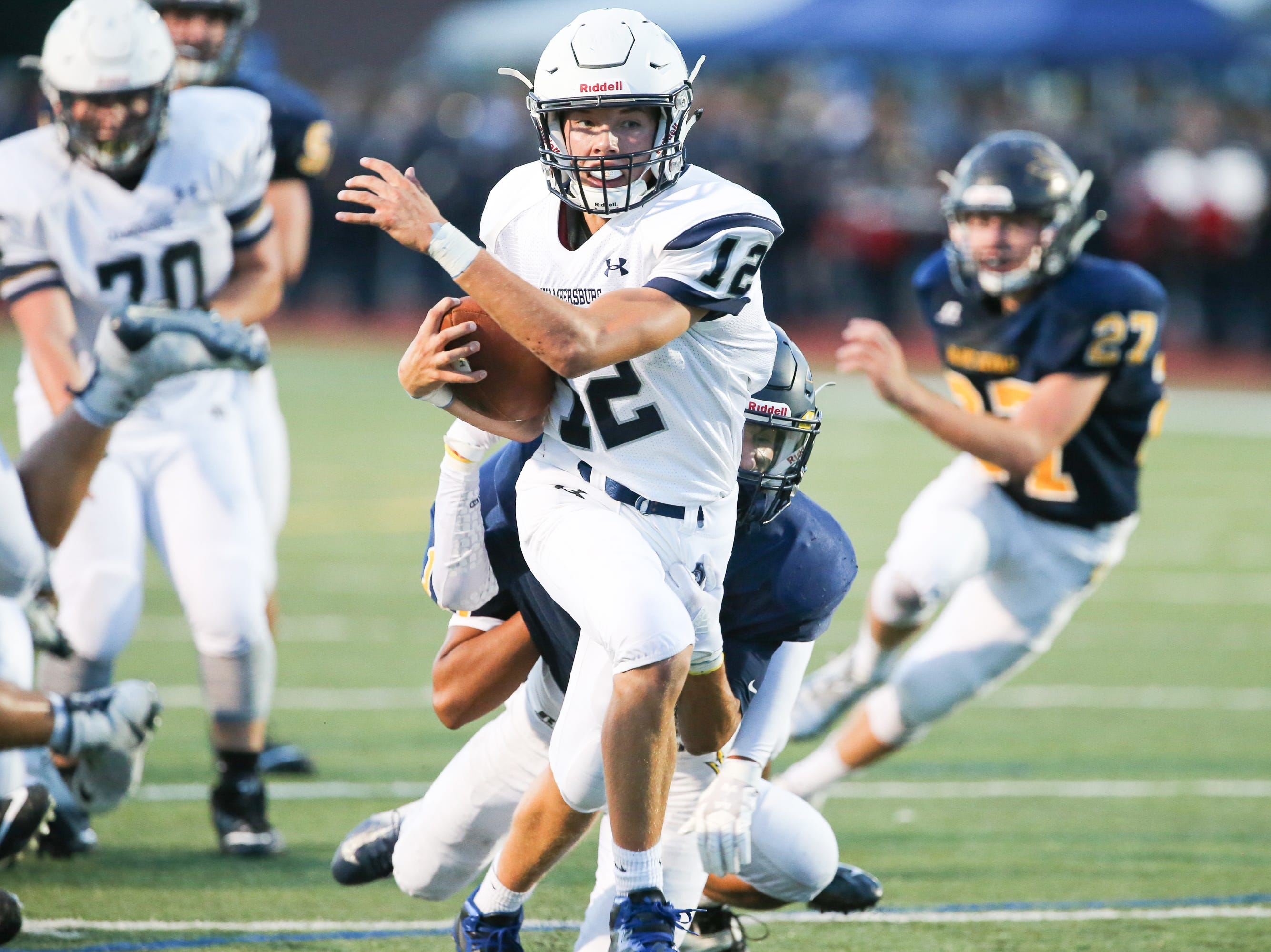 Chambersburg quarterback Brady Stumbaugh (12) takes off on a first down run during the season opener versus Greencastle-Antrim on Friday, Aug. 24, 2018, in Greencastle. Chambersburg won, 48-13.