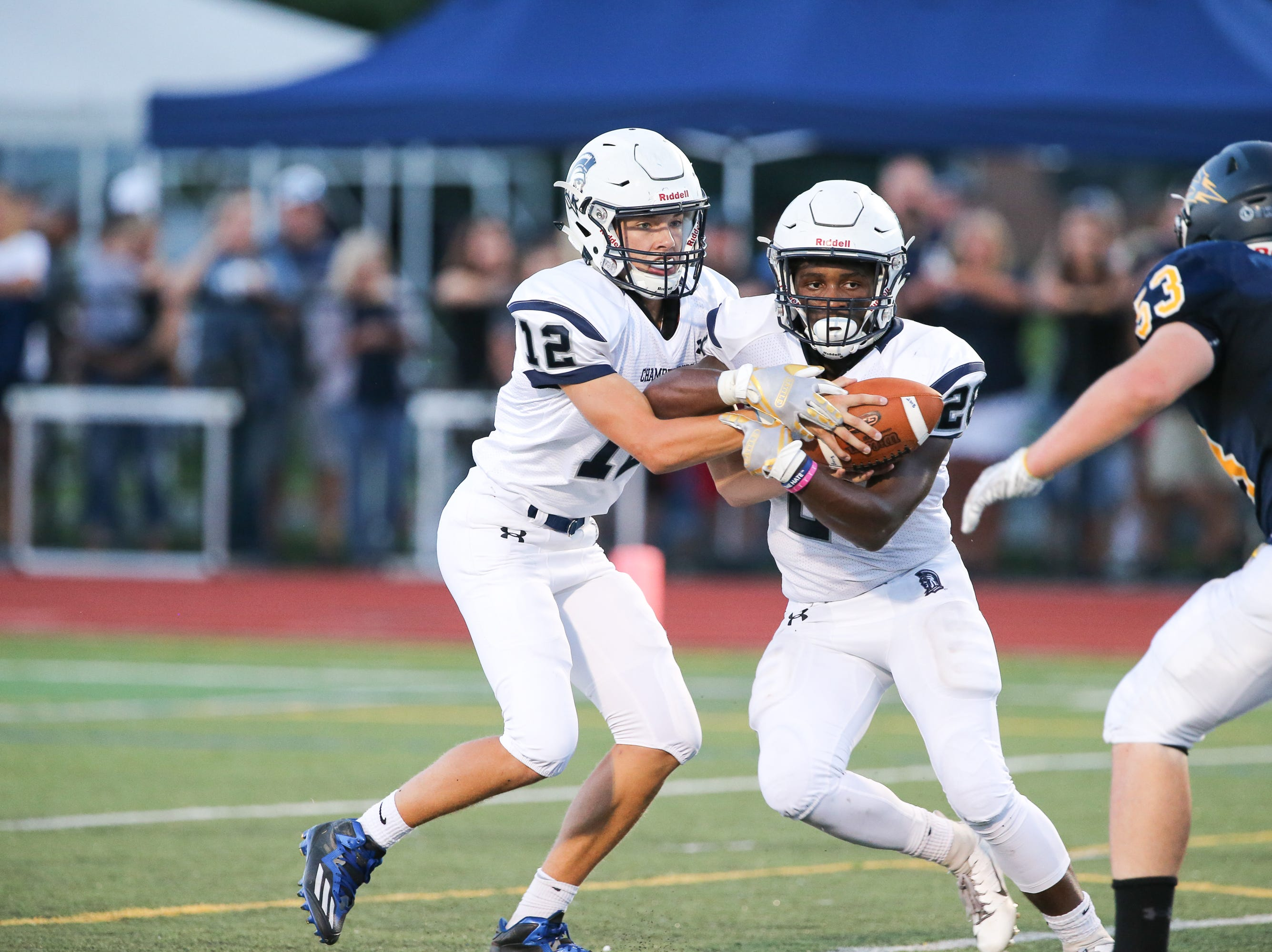 Chambersburg players protect the ball during the season opener versus Greencastle-Antrim on Friday, Aug. 24, 2018, in Greencastle. Chambersburg won, 48-13.