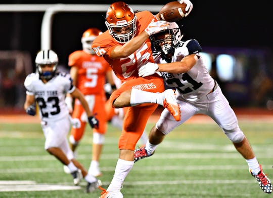 West York's Ethan Sloat, right, looks to take down Central York's Hunter Werner during football action at Central York High School in Springettsbury Township, Friday, Aug. 24, 2018. Central York would win the game 38-14. Dawn J. Sagert photo