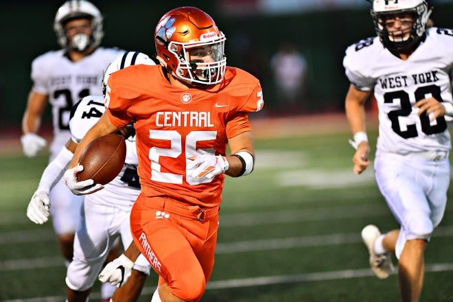 Central York's Hunter Werner, front, runs the ball for a touchdown while West York defends during football action at Central York High School in Springettsbury Township, Friday, Aug. 24, 2018. Central York would win the game 38-14. Dawn J. Sagert photo