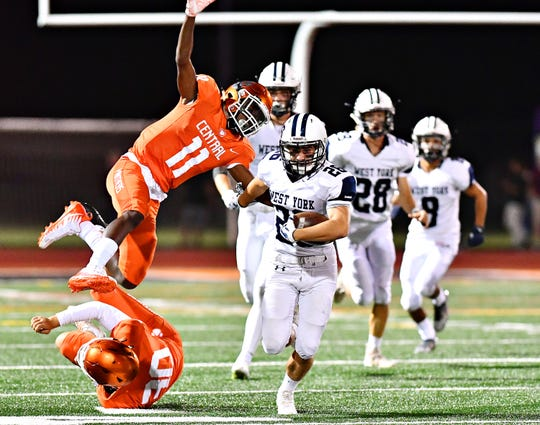 West York's William Shoemaker runs away from the Central York defense earlier this season. The Bulldogs face York Suburban on Friday in a game that has major District 3 playoff implications for both teams. Dawn J. Sagert photo