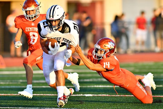 West York's Ethan Sloat tries to break away from Central York's Keelan Stroman earlier this season. The Bulldogs are 0-3, but that record may be deceiving. Their three foes have a combined record of 9-0. Dawn J. Sagert photo