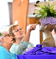 Pat Tillman, left, of New Freedom, and Jeanne Smith, of Norrisville, Md., examine an award-winning arrangement in the professionals category, created by Cindy Cancilla, of Flowers by Cindy in Glen Rock, during the 67th Annual Shrewsbury Flower Show at Assembly of God in Shrewsbury, Saturday, Aug. 25, 2018. Dawn J. Sagert photo