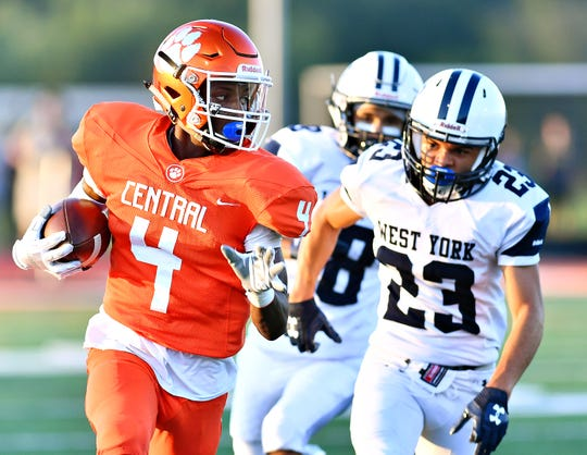 Central York's Saahir Cornelius, left, runs for a touchdown against West York earlier this season. Cornelius is the leading receiver in the league. Dawn J. Sagert photo