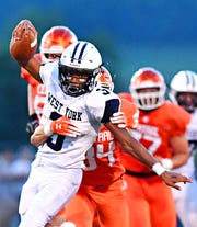West York's Ay'Jaun Marshall tries to avoid a Central York tackler in a game earlier this season. Marshall and the Bulldogs travel to Gettysburg Friday in their D-II opener. Dawn J. Sagert photo