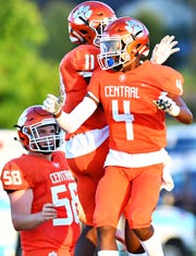 Central York celebrates a touchdown made by Saahir Cornelius, front right, during football action against West York at Central York High School in Springettsbury Township, Friday, Aug. 24, 2018. Central York would win the game 38-14. Dawn J. Sagert photo