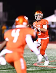 Central York's Cade Pribula, back, looks to pass to Saahir Cornelius in a game earlier this season. Pribula and surpassed former York Suburban passer Thomas Merkle for most passing yards for a York County signal caller. Dawn J. Sagert photo