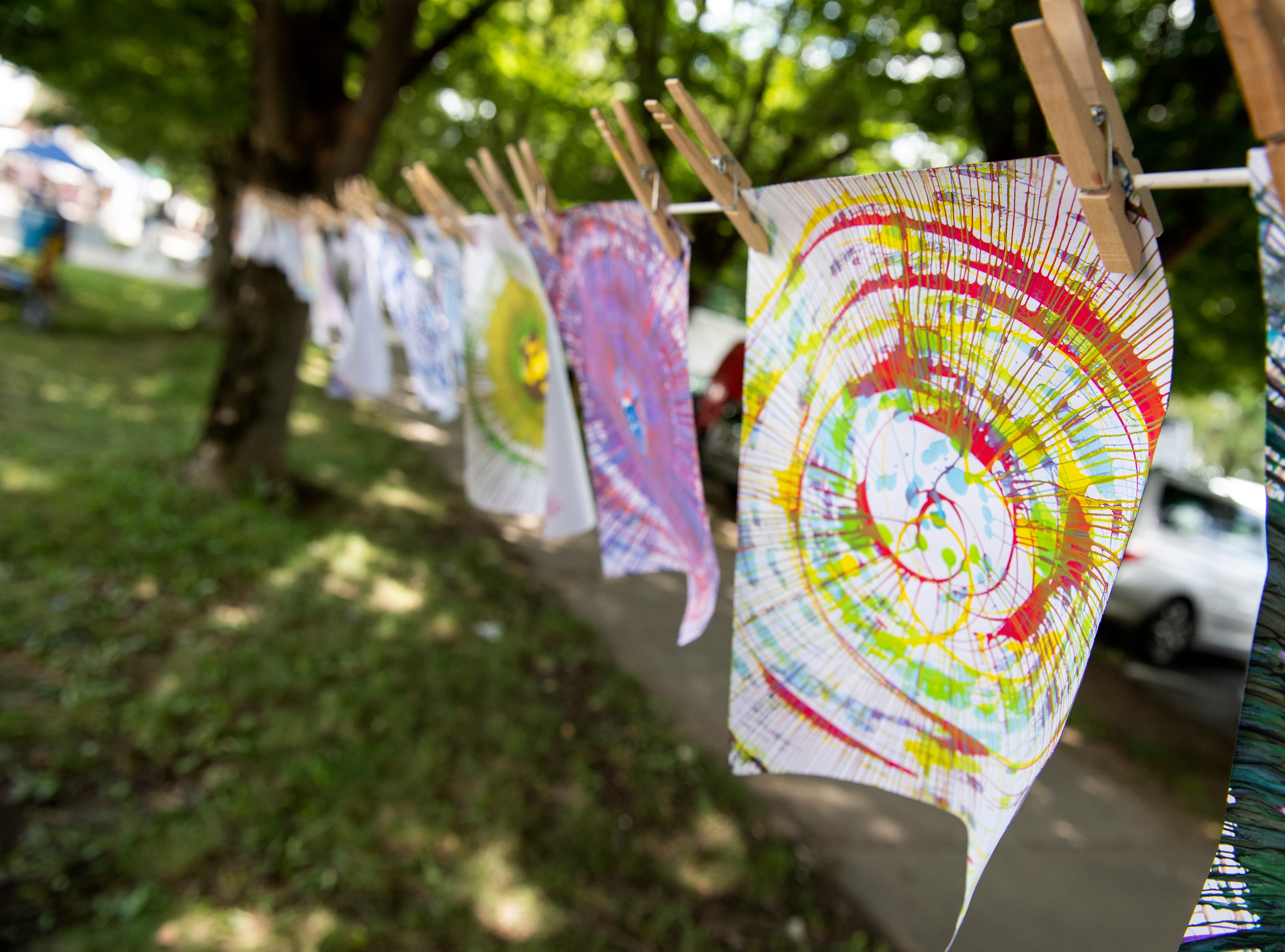 'Spin art' hangs to dry at Yorkfest, Saturday, Aug. 25, 2018. The art festival continues through Sunday, hosting over 100 artists along the Codorus Creek.