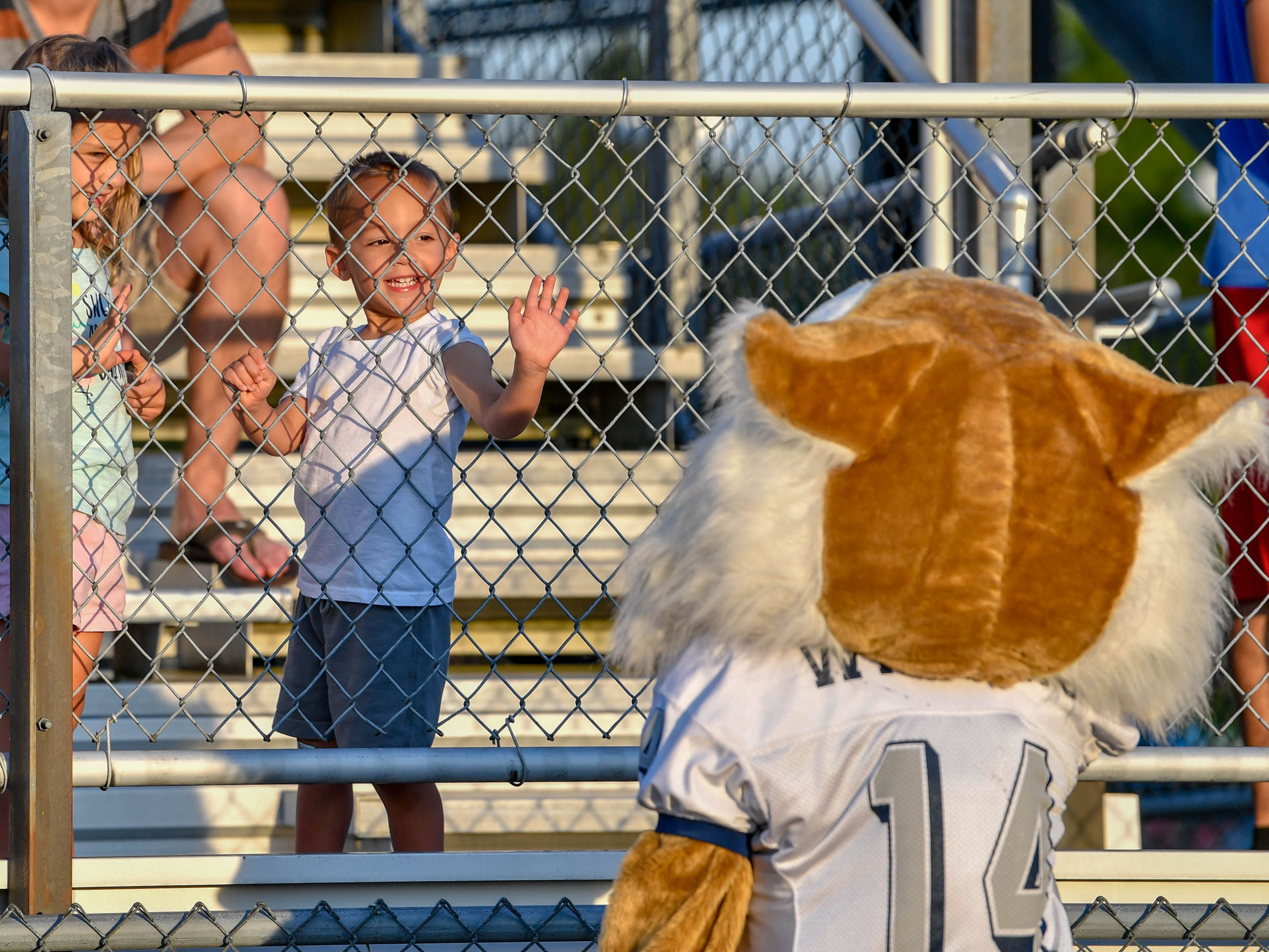 Young Dallastown fans greet Wildcat during the Dallastown home opening game against Hempfield on Friday, August 24, 2018.