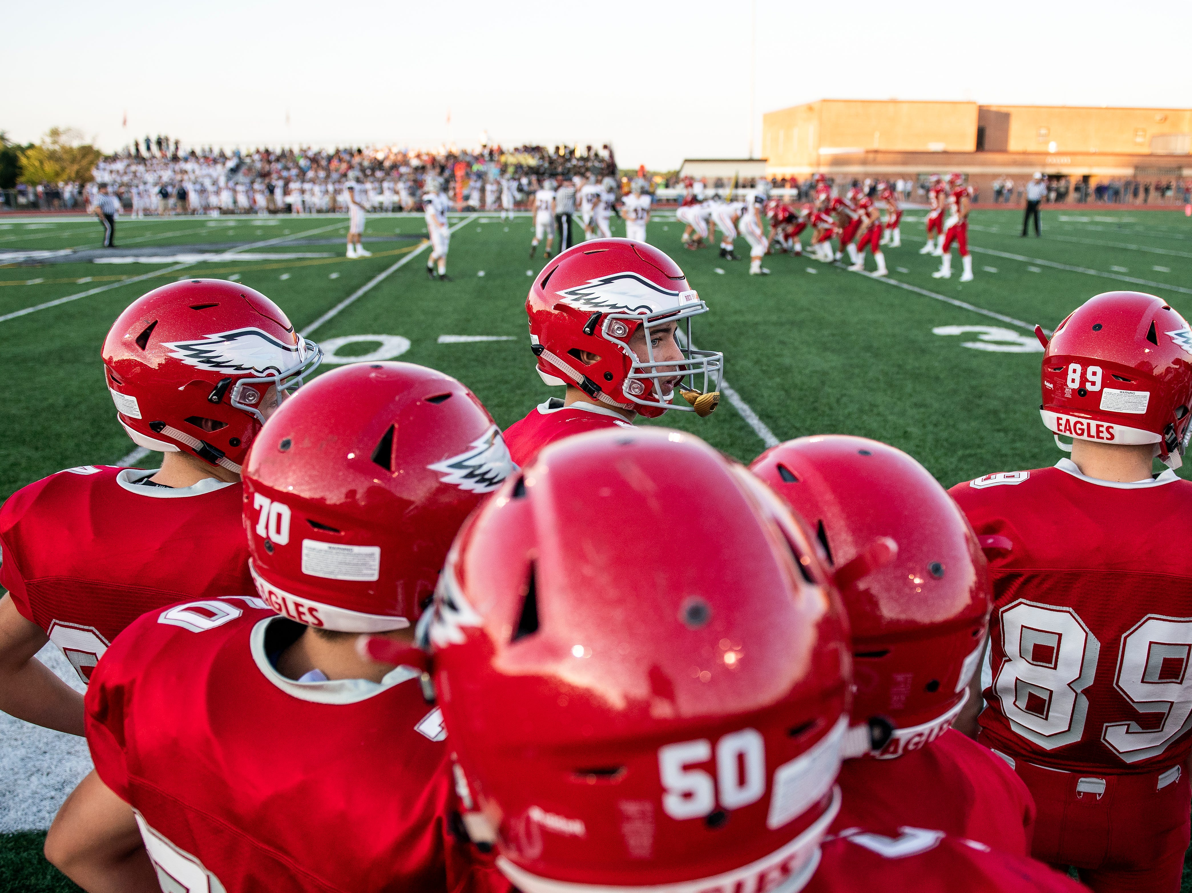 A Bermudian Springs' players looks toward the coach during the Eagles first home game of the season against the New Oxford Colonials, Friday, Aug. 24, 2018. The Eagles skimmed past the Colonials, 28-22.
