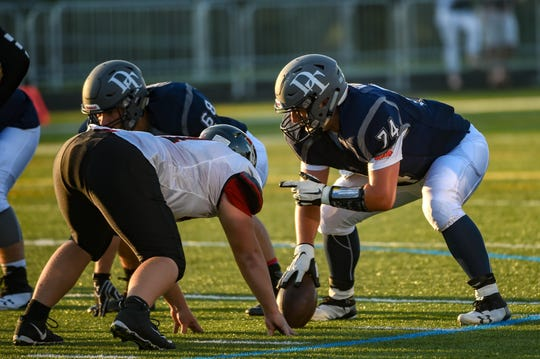 Dallastown's Raymond Christas prepares to snap the ball during their home opening game against Hempfield on Friday, August 24, 2018.