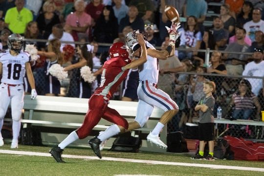 New Oxford's Connor Becker (7) goes up for a pass while Bermudian Springs' Kolt Byers plays defense, Friday, Aug. 24, 2018. The Eagles skimmed past the Colonials, 28-22.