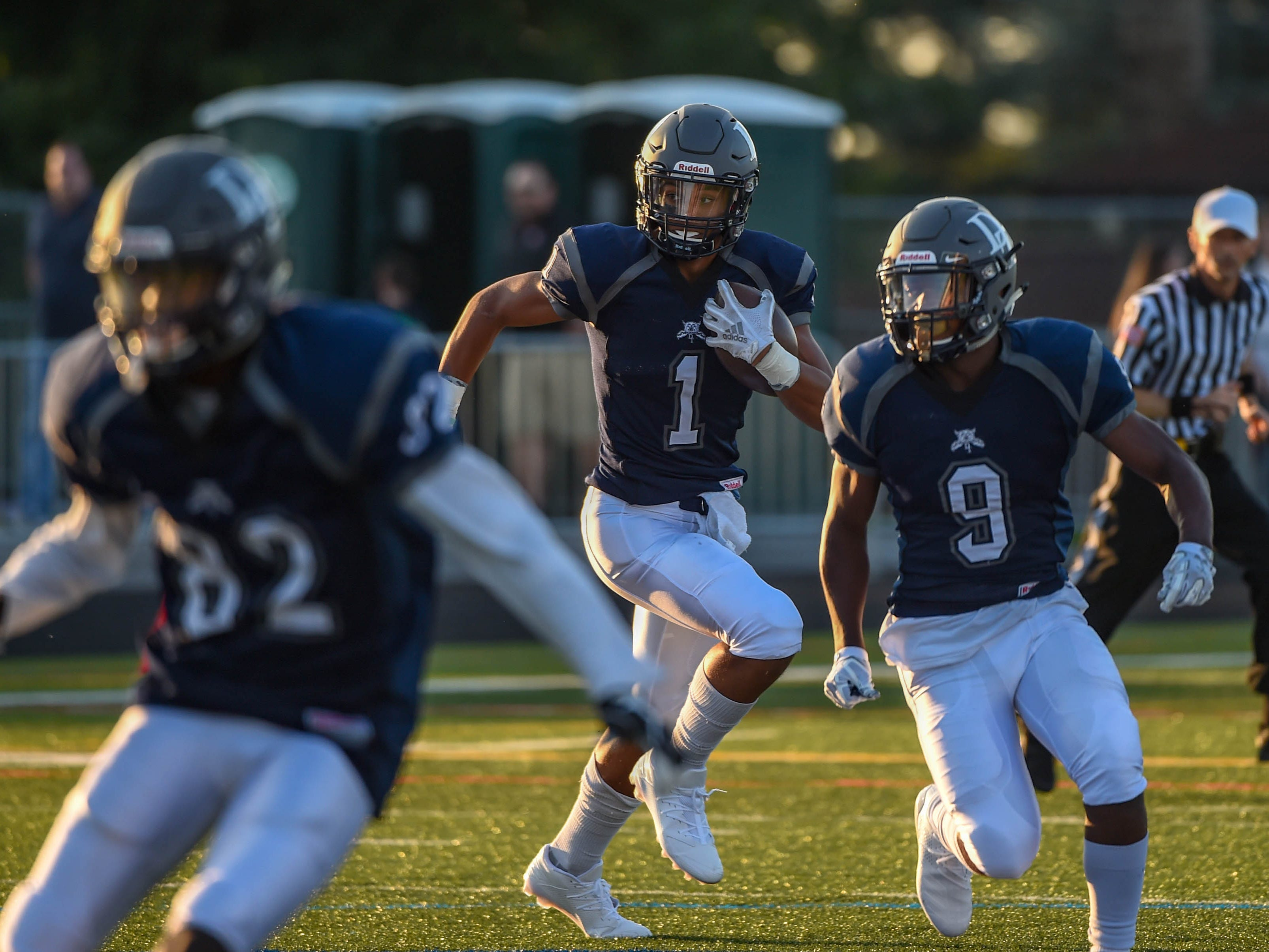 Dallastown Quarterback Jordan Cook runs the ball for a first down during the Dallastown home opener against Hempfield on August 24, 2018.