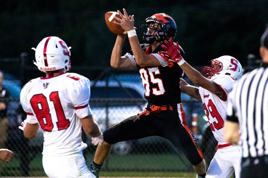 Hanover's Mike Minetos (85) intercepts a pass to Susquehannock's Harry Pecunes (29) in the endzone during a football game between Hanover and Susquehannock, Friday, Aug. 24, 2018, at the Sheppard-Meyers field in Hanover.