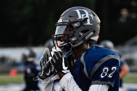 Dallastown Wide Receiver Isaiah Harrison looks to the sideline for the next play their home opening game against Hempfield on Friday, August 24, 2018.