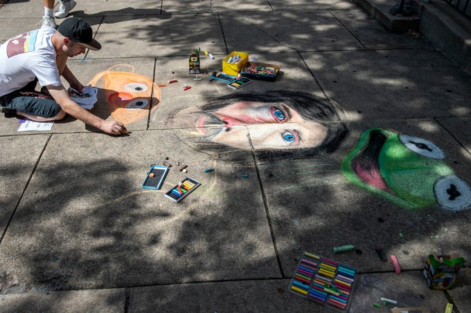 Nathan Bupp, a 25-year old artist from Dallastown, works on his chalk walk piece at Yorkfest, Saturday, Aug. 25, 2018. This is Bupp's fifth year chalking up art on the downtown sidewalks.