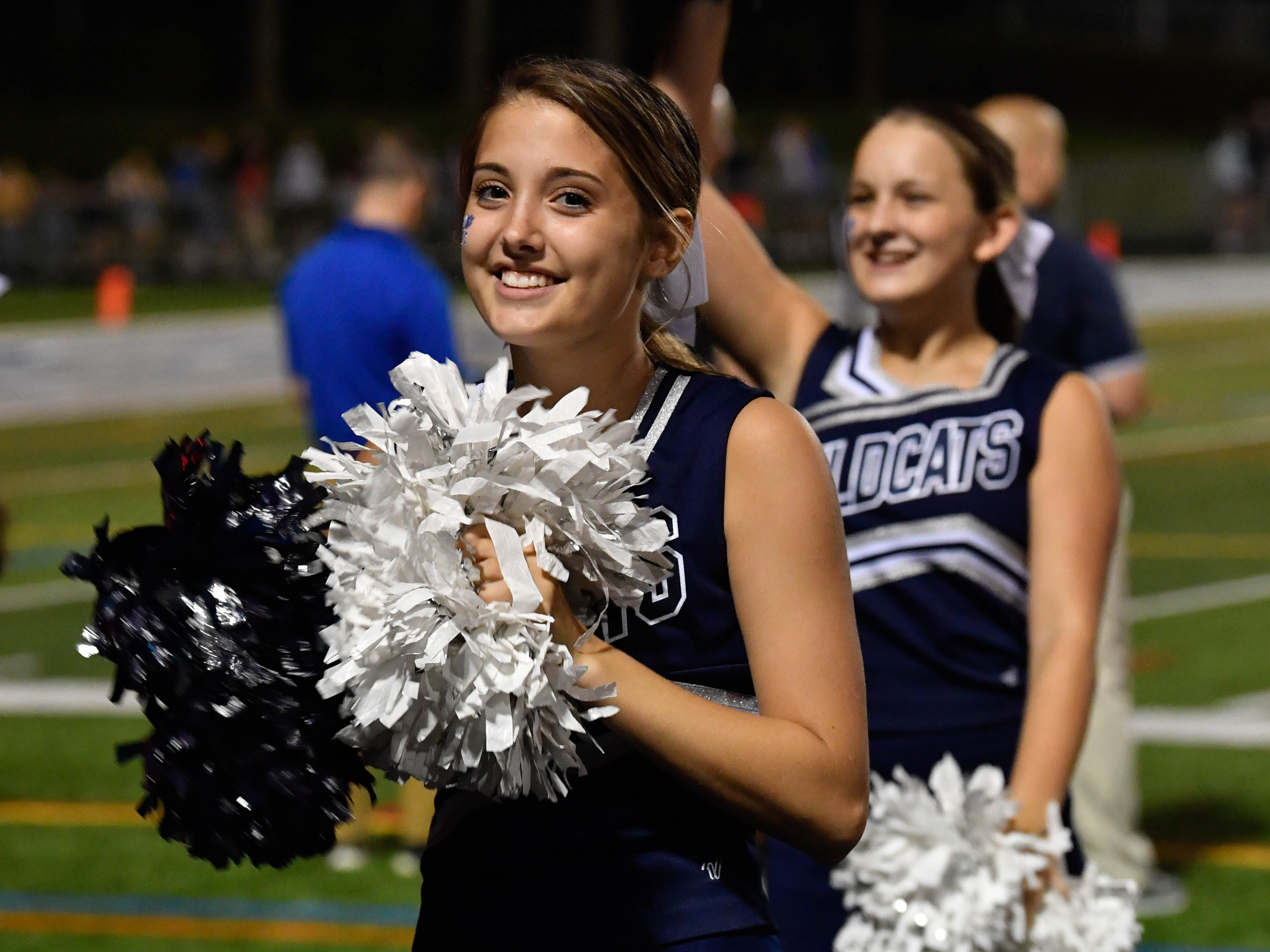 Dallastown cheerleaders hype up the crowd during the home opening football game against Hempfield on Friday, August 24, 2018.