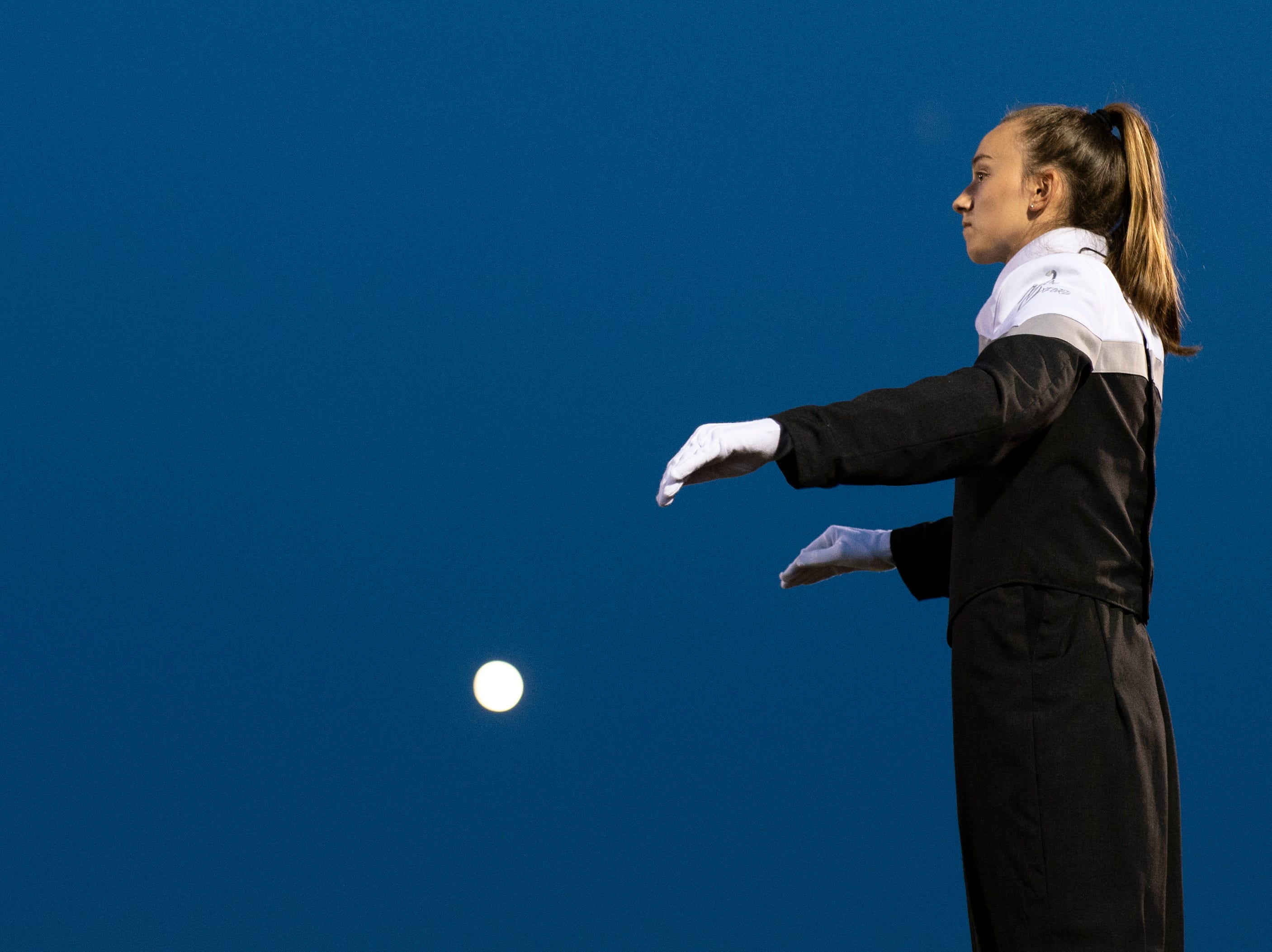 New Oxford drum major Daelyn Stabler directs the band at halftime, Friday, Aug. 24, 2018. The Eagles skimmed past the Colonials, 28-22.