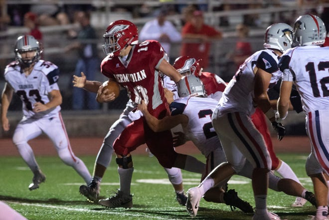 Bermudian Springs' Chase Dull (10) runs the ball up the field, Friday, Aug. 24, 2018. The Eagles skimmed past the Colonials, 28-22.