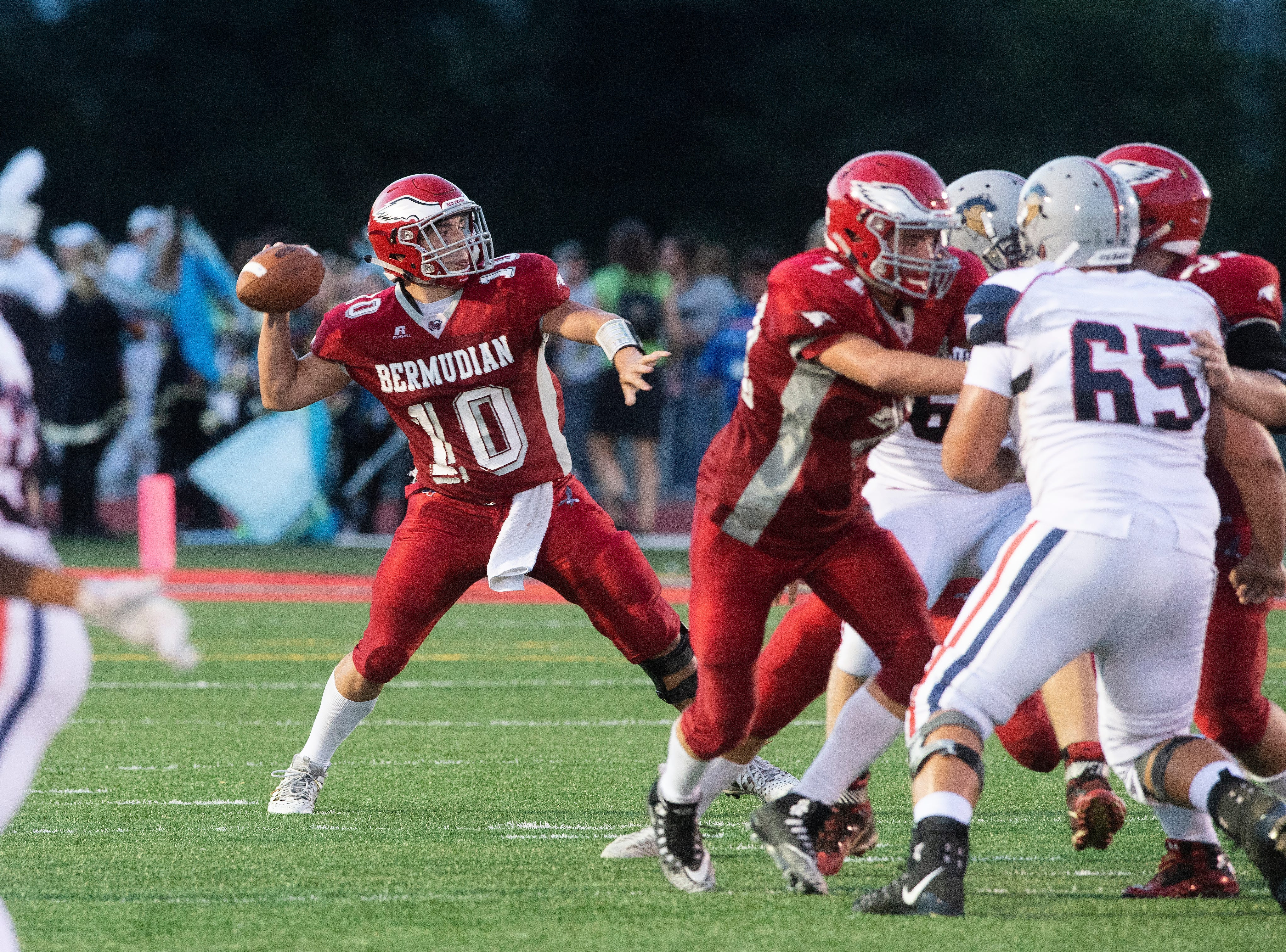 Bermudian Springs quarterback Chase Dull (10) gets set to pass, Friday, Aug. 24, 2018. The Eagles skimmed past the Colonials, 28-22.