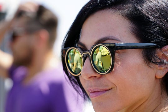 Burning Man participant Tara Brooks smiles as she watches friends prepare for the event at a Walmart Supercenter in Reno, Nevada.