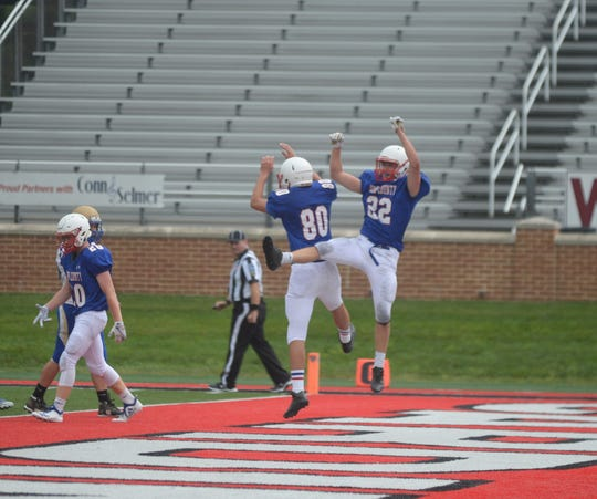 Union County's Nate Webb (22) and Ryan Hensley (80) celebrate after Hensley caught an 11-yard touchdown pass during Saturday's football game between Lincoln and Union County at Ball State University's Scheumann Stadium Aug. 25, 2018.