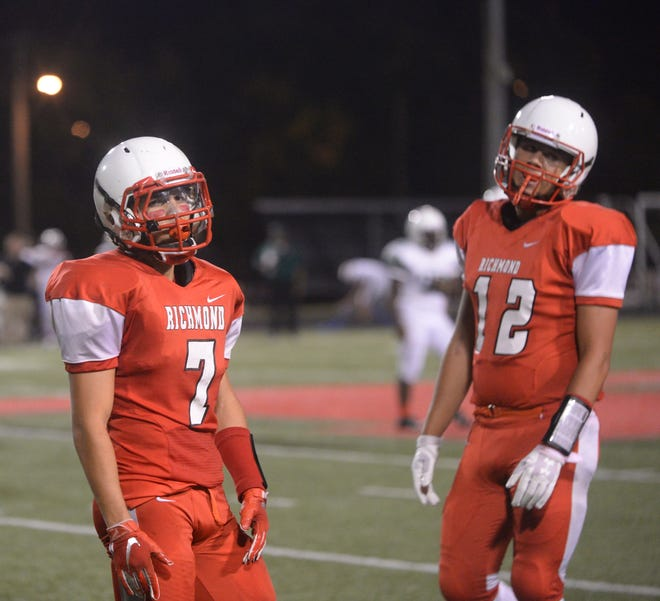 Richmond's Julian Holguin (7) and Zach Hill during Richmond's 52-7 loss to Lawrence North Friday, Aug. 24, 2018 at Lyboult Field.