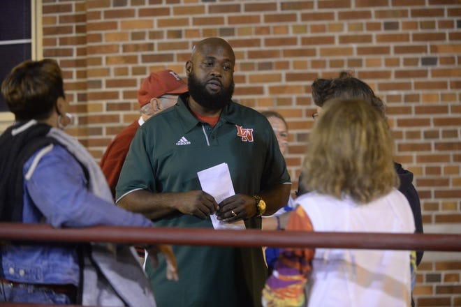 Former Richmond High School boys basketball coach Rick Wedlow, now an employee at Lawrence North, visits Lyboult Field during Richmond's 52-7 loss to Lawrence North Friday, Aug. 24, 2018 at Lyboult Field.