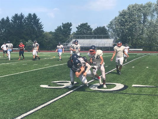 The Pittsford Panthers complete a pass during a scrimmage with Buffalo Bennett of Section VI in 2018.