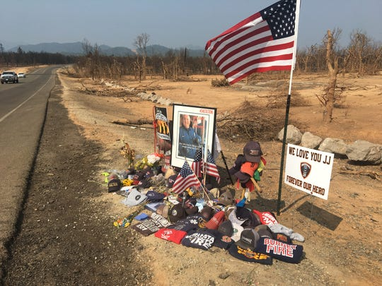 A growing memorial paying tribute to Redding fire prevention inspector Jeremy Stoke, who lost his life on July 26, sits along Buenaventura Boulevard.