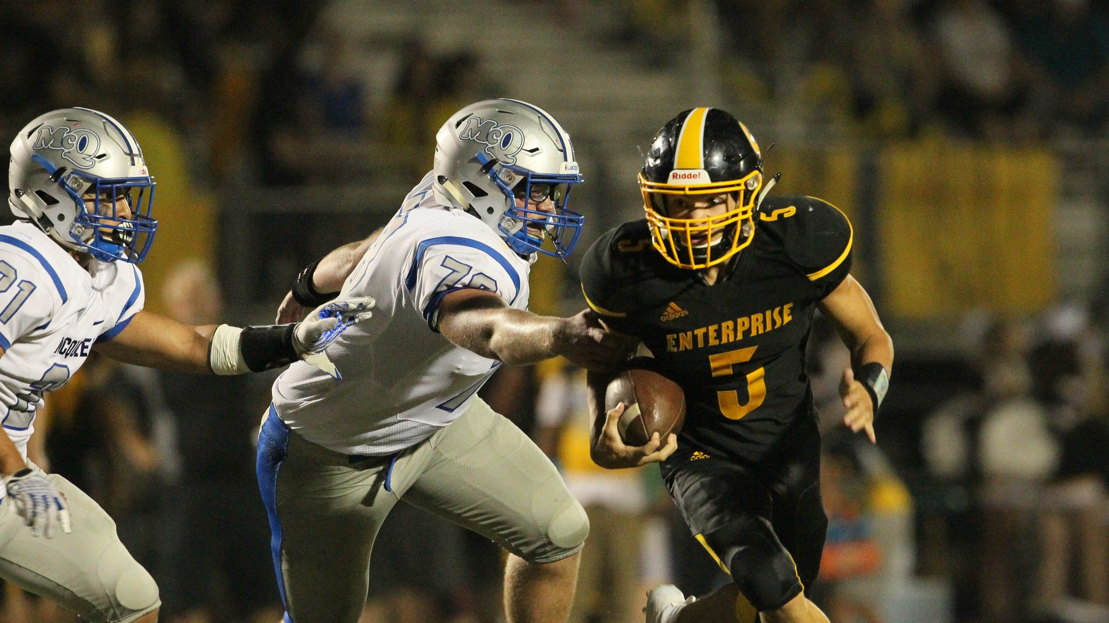 Enterprise running back Anthony Norman (5) runs in the Hornets' season opener against McQueen. The Hornets face Foothill on Friday.