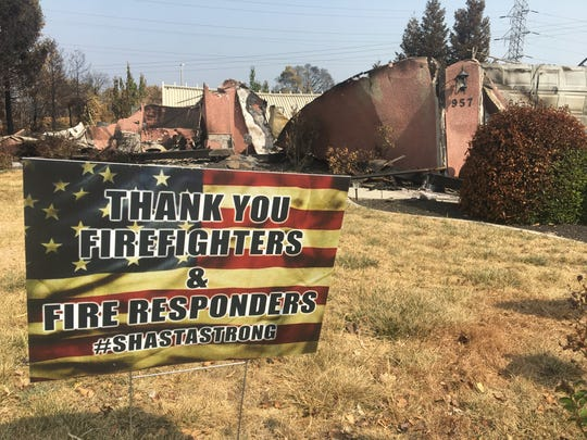 """""""THANK YOU FIREFIGHTERS & FIRE RESPONDERS #SHASTASTRONG"""" read a Redding sign near a home demolished by the Carr Fire in the Land Park neighborhood."""