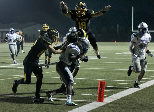 Enterprise's QB, Leslie Cummings (18) leaps into the end zone for a touchdown in the 2nd quarter of the game on Friday, Aug. 24, against McQueen (Reno, NV). The Hornet lost to McQueen, 14 - 51.