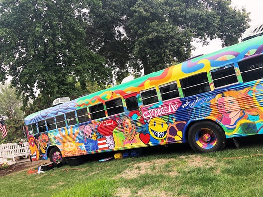 The Painting Bus, located in the Artisan Village at the Oregon State Fair, offers art classes and demonstrations to fairgoers.