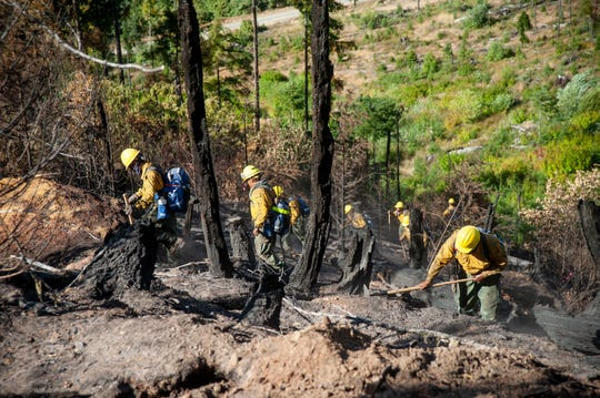 Oregon National Guard members work on the fire line of the Garner Complex Fire in Southern Oregon in August 2018.