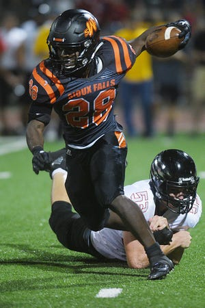 Washington's Tupak Kpeayeh goes against Brandon Valley defense during the game Friday, Aug 24, at Howard Wood Field in Sioux Falls.
