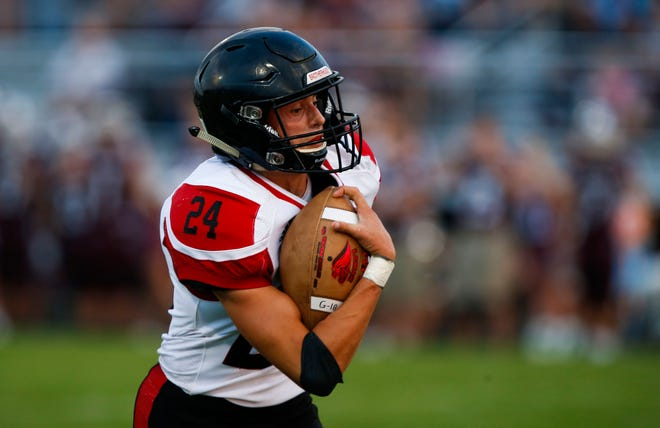 Lamar High School senior Landon Hardman carries the ball for a touchdown after catching a pass during a game against the Logan-Rogersville Wildcats on Friday, Aug. 24, 2018.