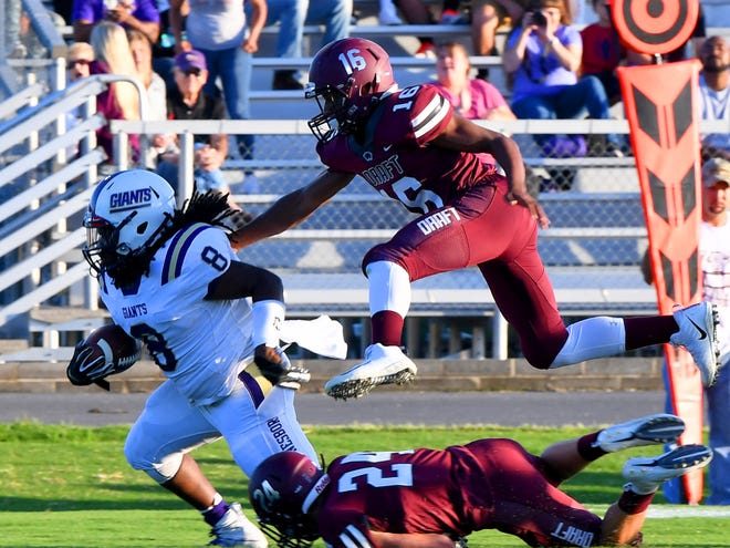 Stuart's Draft's Latrell Fomby jumps over fallen teammate Aaron Nice as he chances after Waynesboro ball carrier, Alijah Braxton during a football game played in Stuarts Draft on Friday, August 24, 2018.